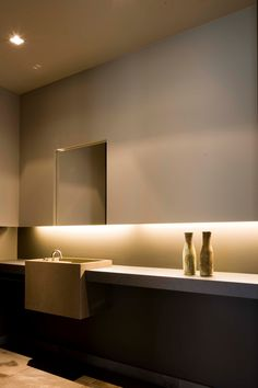 Image Credit: interieurarchitect Frederic Kielemoes Lovely use of drywall detailing to frame a hung mirror and provide recessed lighting, ambient lighting proves to be a much more interesting way to illuminate surfaces.
