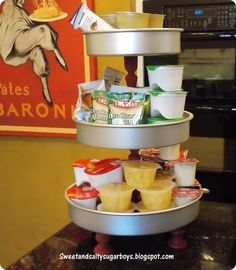Keep snacks accessible for your kiddos by turning cake pans into a Pottery Barn inspired snack stand!