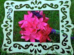 Souvenirs Pliées: My photographer friend appropriately framed my paper flowers during one of her photo shoots.