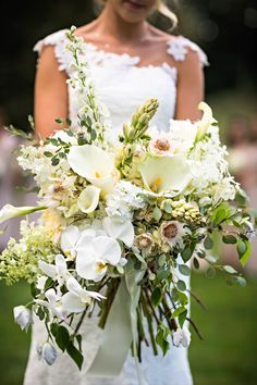 Alexandra's oversized bouquet was a dramatic mix of lilies, orchids, tulips, dahlias, calla lilies in shades of white and cream. Hydrangea Bouquet Wedding, Calla Lily Wedding, Calla Lily Bouquet, Cascade Bouquet, Floral Wedding, Wedding Bouquets, Wedding Flowers, Calla Lilies, Wedding Dresses
