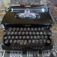 Vintage Corona Sterling Typewriter / LC Smith Corona Typewriter / L.C. Smith & Corona Typewriter / Black Metal Typewriter by ThingsofOld on Etsy https://www.etsy.com/listing/237764487/vintage-corona-sterling-typewriter-lc