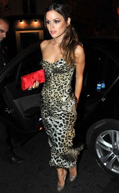 Rachel Bilson. Nothing is sexier than a whole lot of leopard and a bold red clutch.