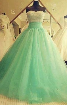 Pretty mint green ball gown with strapless sweetheart bodess