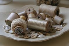 old buttons and threads would look good in a old mason jar