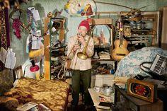 Evgenia Arbugaeva: Uncle Vanya practises trombone at his house.