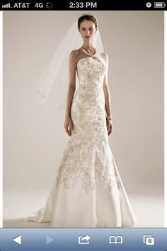 Ivory mikado fit-and-flare gown, champagne all over beaded lace. Fit and flare silhouette slims and lengthens the body. Sweep train.