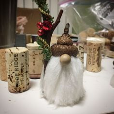 Wine cork gnomes with acorn hats. Use wood push pins for the noses. So easy! #winecorkcrafts #winecorks