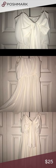 White bow dress White spaghetti strap dress  Bow in front Worn twice  From Shop Hopes Dresses Mini