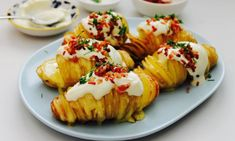 """Stuffed with cheesy goodness and loaded up with sour cream, bacon and chives, these next-level hasselback potatoes will disappear faster than anyone can say, """"Hassel-what? Cheesy Recipes, Potato Recipes, Vegetable Recipes, Vegetable Dishes, Hassleback Potatoes, Creamed Potatoes, Kid Friendly Dinner, Kid Friendly Meals, Good Food"""
