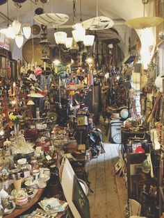 """From Blog on Prague trip: bric-brac shop in Prague. """"passing over the Charles Bridge and returning again into the bustle of Old Town. I happened upon an amazing """"bric & brac"""" vintage shop covered from floor to ceiling in antique treasures"""""""