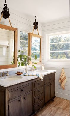 The ingenious solution: Suspend mirrors from the ceiling! To do so Bonnie equipped West Elm mirrors with pulleys (purchased from a hardware store and spray-painted black) and hung them with thick sisal rope (also from a hardware store). - CountryLiving.com