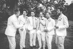 Image by Amy Faith Photography - Bespoke low back lace wedding dress with custom made Tommy Hilfiger Shoes for an all white, outdoor, bohemian, country wedding in Kent. Groomsmen & Bridesmaids wear high street fashion.