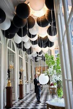 Black and white party balloons, put a penny in balloon to make it hang upside down...