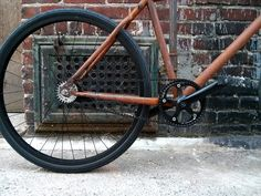 The Rust Bike by Josh Bechtel. Intentionally rusted in a failed attempt to be unattractive. This one sports a Gates Carbon Belt Drive and a 2-speed Sturmey Archer Duomatic Kick Shift 2 speed hub...
