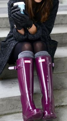 Pop of purple. Black coat, socks and purple Hunters boots.