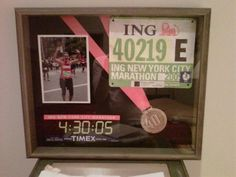 Marathon shadow box. I like this layout. Perfect for NYC marathon medal & number when I get it.