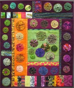 Yo yo quilts are created in many forms. I like this one, as much as the traditional yo yo quilt.