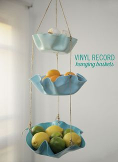 Organization for the kitchen, bathroom, well really any room in the house, is a must! And something that looks pretty too? That's a win-win! Well this DIY fits the bill! Snag some old vinyl records and transform them into hanging baskets. They're sure to add a vintage charm to your home. These DIY Vinyl Record Hanging Baskets can store produce, hand towels, kids toys, and more!