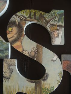 """Made these for my niece's nursery!  I bought her initials are a craft store and covered them with pages from one of my favorite children's books, """"Where the Wild Things Are"""""""