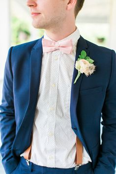 Navy blue blazer and trousers with white and black polka dot button down topped with a pink bowtie https://www.thecelebrationsociety.com/weddings/stylish-colorful-summer-wedding-ellery-farms-woodruff-south-carolina/