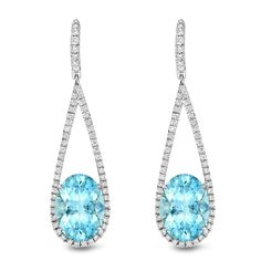March's birthstone, aquamarine, translates as 'sea water,' including light watery hues like these earrings designed by Tamir. The Bright Aquamarine Diamond Drop Earrings feature oval-shape aquamarines (15.9 cts. t.w.), encircled by 1.53 cts. t.w. diamonds and set in white gold. www.diamonds.pro