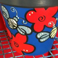 Check out this item in my Etsy shop https://www.etsy.com/listing/225771604/hand-painted-terracotta-pot-with-bees