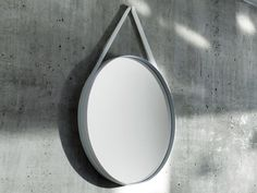 The Hay Strap Mirror is a circular mirror that is suitable for all areas of the home.