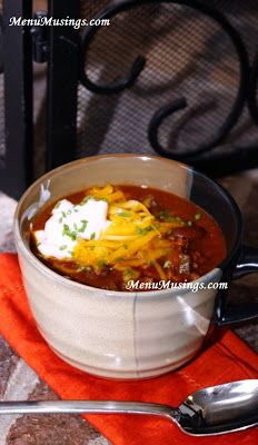 Man Chili - There's nothing like a big hot bowl of chili to warm your family up!  This one is a basic, delicious chili that the men in your life will love.  No turkey or tofu in this one!  Just big beefy chili.  Step-by-step photo directions.