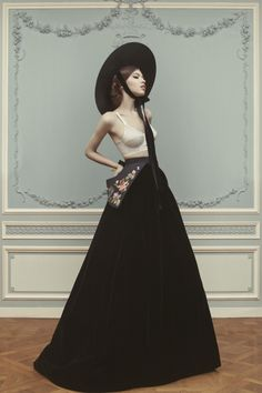 Last summer, Russian designer Ulyana Sergeenko famously showed up in Paris to show her Haute Couture collection. Despite a formal invitation from France's Fédération Française de la Couture, the designer returned in January, with a gorgeous fairy tale-inspired collection of bustles, ballgowns, embroidered details and more. Here is the lookbook shot by photographer Nickolas Sushkevich.