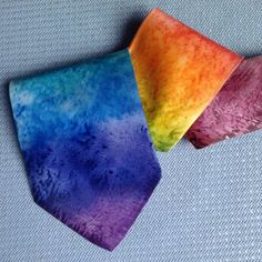 Rainbow Marble - Hand Painted Silk Tie / Necktie  from the point to the thin end - purple, royal blue, blue, turquoise, green, yellow, orange, pink red, red, and the whole of the thin end is plum - marbled pattern  Free postage within the UK - anywhere else the cost is to cover the postage.     A standard tie shape, 9cm wide and approximately 144cm long  If you would like the exact length please contact.  The silk used is a Matt crepe backed satin, which gives 'body' to the tie i.e. not a…