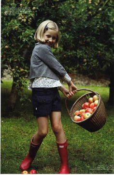 """And pluck til time and times are done the silver apples of the moon, the golden apples of the sun."" (Love the red Hunter wellies too!)"