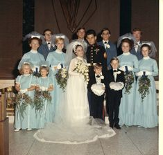 1971: Pretty bride and small bridesmaids dresses, the grownup bridesmaids look a bit Matronly though!
