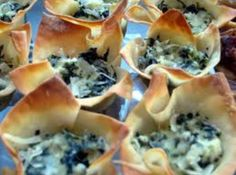 Was at a friends house a couple of weeks ago and she had these pastry cups filled with ricotta and spinach.They were so good that I asked her for the recipe. I changed it just a little by using wonton wrappers instead of pastry and they turned out so good. This will be one of my appetizers at my next part for sure. Another thing I like about these are; they are only 50 calories with only 2 grams of fat. How good is that?