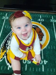 6 months old and already loves the #Redskins! Sent in by Megan.