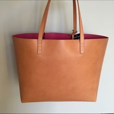"""Mansur Gavriel Large Tote Bag Cammello Dolly Pink 100% Authentic & NWT. Can provide copy of receipt upon request. Contact me for lower price!  Color: Cammello / Dolly Size: 11.5"""" H X 19.5"""" W X 6"""" D Italian vegetable tanned leather cammello tote bag with pink interior matte patent. Detachable wallet and adjustable strap. Made in Italy. Mansur Gavriel Bags Totes"""