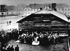 The Women's (or Girl's) Orchestra of Auschwitz perform in 1943. Formed by Maria Mandel, the Women's Orchestra of Auschwitz had several tasks: to welcome new inmates to Birkenau (and so mask the true nature of the camp), to accompany selections, to march the prisoners to work, and to entertain the SS. (on a birthday or other celebration). Occasionally (for propaganda purposes) they were permitted to perform for other prisoners. In Nov 1944, the Orchestra were sent to Bergen-Belsen in…