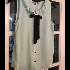 Very Light Sea Foam Green Blouse with Black Tie Beautiful ruffle collar blouse with black tie and buttons. Size small lightweight sea foam light green. Forever 21 Tops Blouses