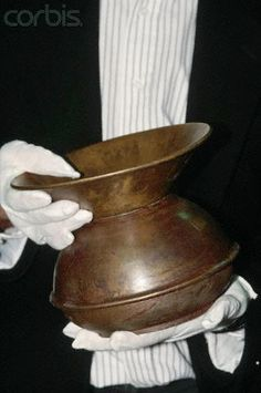 April 1997, Memphis, Tennessee, USA --- A spittoon recovered from the wreck of the RMS Titanic is displayed at an exhibition in Memphis, Tennessee.