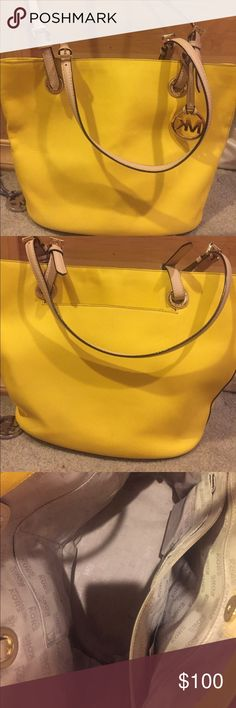Yellow Michael Kors pocket book Yellow leather Michael Kors pocket book. Small scratch on the front (last picture) gently used, in great condition. Michael Kors Bags Shoulder Bags
