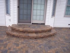 In the backyard, instead of filling in the washed out area under the patio, level the area with the bottom of the stairs and put these by the basement door.