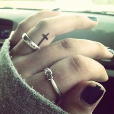 Small tattoos on the finger and inside of the finger are one of the hottest trends lately. Especially inner finger tattoos are the most eye Trendy Tattoos, Tattoos For Guys, Cool Tattoos, Tatoos, Simple Tattoo Designs, Tattoo Designs Men, Piercing Tattoo, Simple Cross Tattoo, Feminine Cross Tattoo