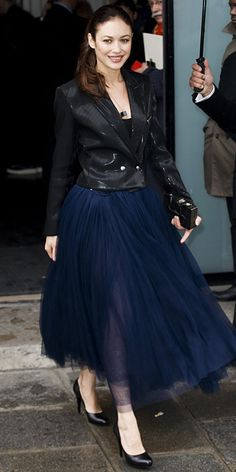 Olga Kurylenko joined in on the theatrics at the Jean Paul Gaultier spring 2014 couture show, standing out in a full tulle navy ball gown that she layered with a fitted tuxedo blazer and styled with black pumps.