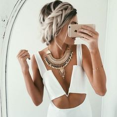 This crown  fishtail braid by @emilyrosehannon is totally giving us an edgy modern day princess  vibe! Who needs a fairy godmother  when you can easily create this chic look with just a few twists and tucks?! ✨#NuMestyle #hairoftheday #braidideas