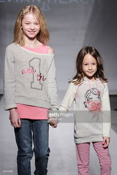 Model Iva Stojanovic (R) walks the runway at the Silvian Heach fashion show during the 2013 petitePARADE Kids Fashion Week at the Industria Superstudio on March 10, 2013 in New York City.
