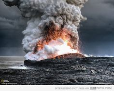 Lava flowing into the ocean - Amazing photo of lava getting into the ocean water creating fireworks and lots of steam.