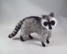 Meet Elliott!!!! Hes a very crafty, curious little raccoon!!! He is 100% wool over a wire armature with glass bead eyes and a lot of personality!!!!! Yours will be very similar to this one which is right around 3-4 inches tall. PLEASE NOTE... the little raccoon pictured above has already found a new home, but I will needle-felt you one of your very own that is very similar to the one above!!!  If youre not familiar with needle-felting, dont worry... a lot of people arent!! Its a process…