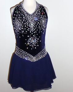 Gorgeous, midnight blue dress. I would get rid of the extra crystal circle-ish designs in the middle, and just keep the waistline and neckline crystalled.