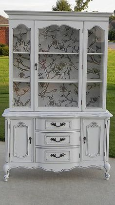 Nature inspired fabric lining the back of this gorgeous hutch.  #springintothedream