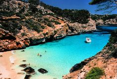Turquoise Beach, Majorca, Spain. This looks amazing, almost like it's not even real.