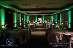 Accent green uplighting throughout a hotel ballroom can look great! DIY and get the look for your event at http://RentUplights.com @Rent Uplights